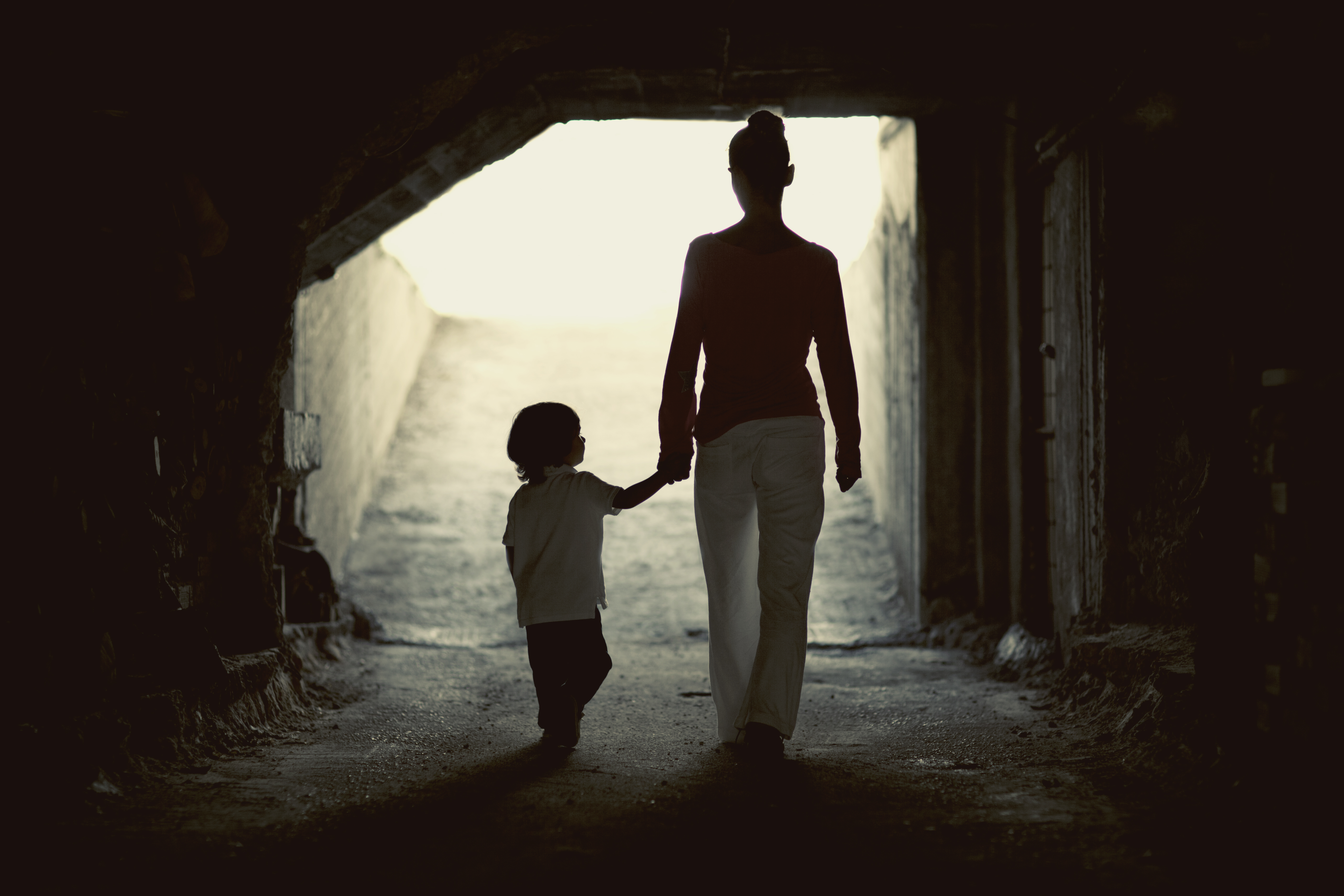 Mother walking in the dark with her son
